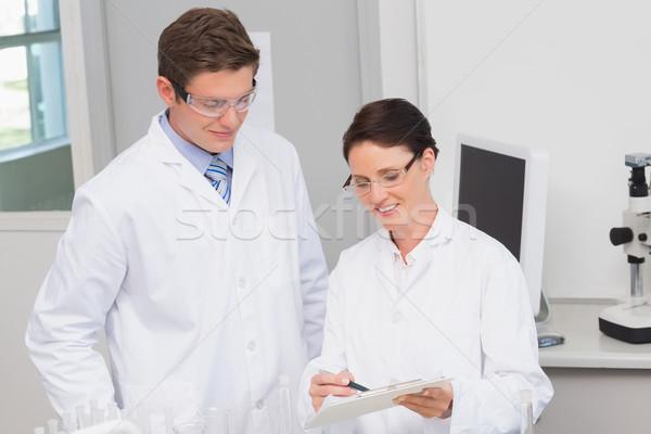 Gülen bilim adamları bakıyor laboratuvar kadın Stok fotoğraf © wavebreak_media