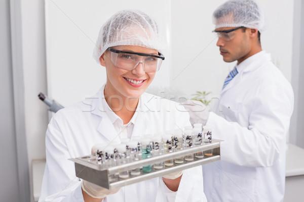 Gelukkig wetenschappers laboratorium vrouw Stockfoto © wavebreak_media