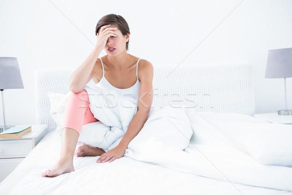 красивая женщина страдание головная боль домой спальня здоровья Сток-фото © wavebreak_media