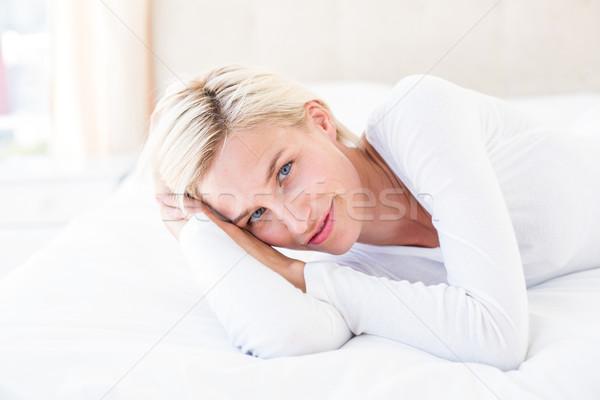 Gülen sarışın kadın yatak yatak odası ev kadın Stok fotoğraf © wavebreak_media