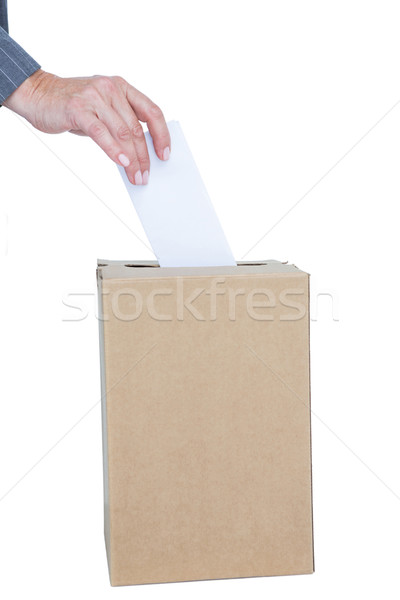 Businessman putting ballot in vote box Stock photo © wavebreak_media