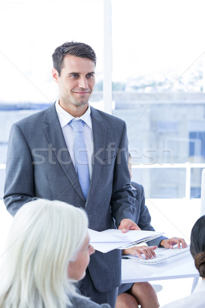 Businessman give a paper  Stock photo © wavebreak_media