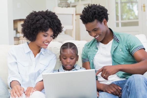Glückliche Familie Couch Laptop home Wohnzimmer Computer Stock foto © wavebreak_media
