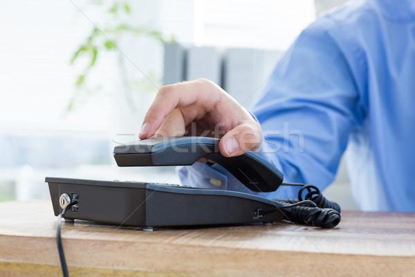 Işadamı cevap telefon ofis el klavye Stok fotoğraf © wavebreak_media