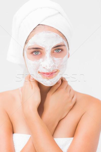 Pretty woman having white cream on her face  Stock photo © wavebreak_media