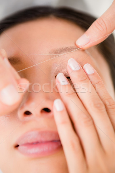 Hands threading beautiful womans eyebrow Stock photo © wavebreak_media