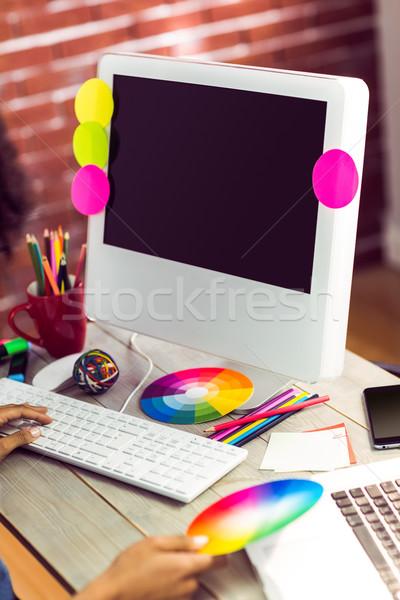 Stock photo: Female graphic designer working at desk
