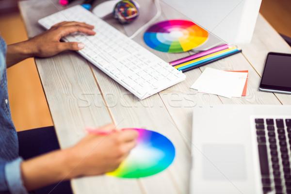 Graphic designer working with colour chart  Stock photo © wavebreak_media