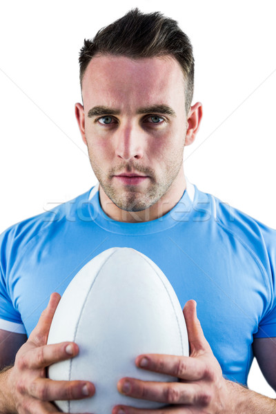 Rugby player looking at camera with ball Stock photo © wavebreak_media