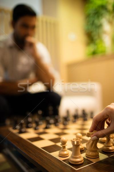 Mano mujer de negocios jugando ajedrez masculina colega Foto stock © wavebreak_media