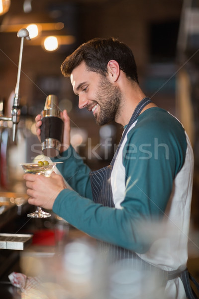 Side view of smiling bartender making drinks Stock photo © wavebreak_media