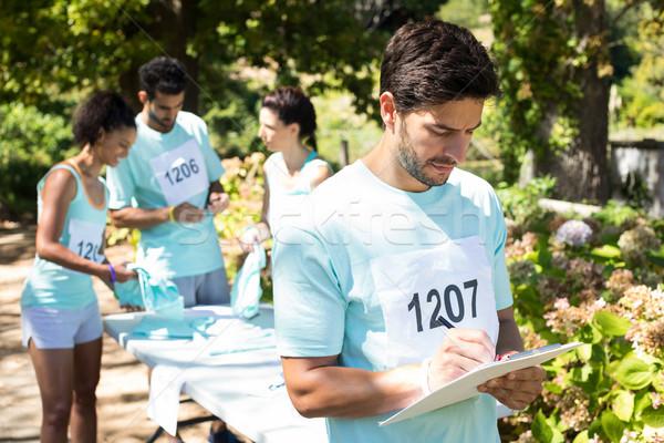 Stock photo: Athletes registering themselves for marathon