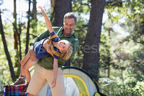 Father and son enjoying on sunny day at campsite Stock photo © wavebreak_media