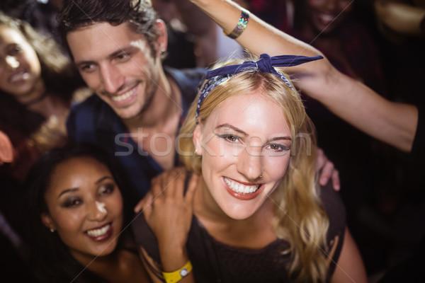 Portrait of happy woman with friends at nightclub Stock photo © wavebreak_media