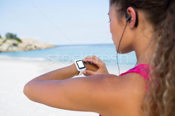 Woman using smart watch while jogging Stock photo © wavebreak_media