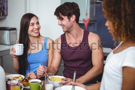 Two women interacting with each other while having wine Stock photo © wavebreak_media