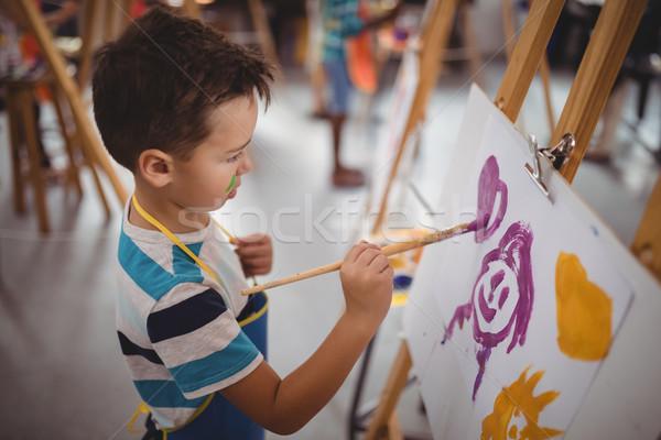 Attentif écolier haletant toile dessin classe Photo stock © wavebreak_media