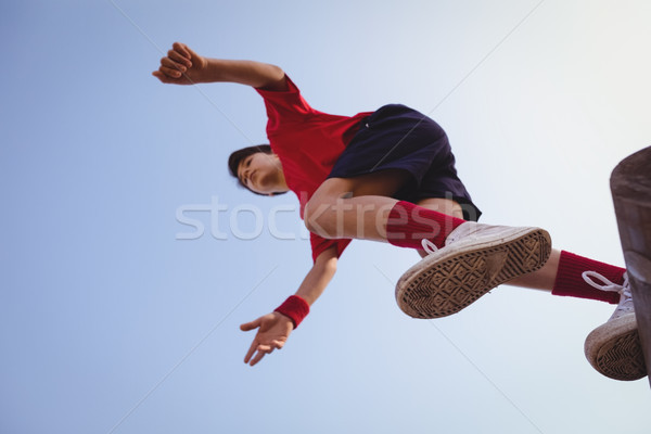 Determined boy jumping over obstacle Stock photo © wavebreak_media