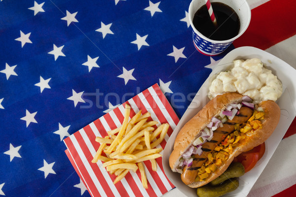 Hot dog served on plate with french fries and cold drink Stock photo © wavebreak_media