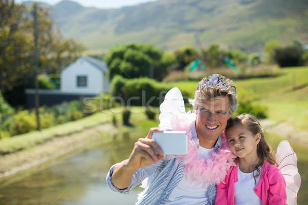 Sorridente pai filha fadas traje Foto stock © wavebreak_media