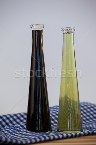 Close up of olive oil bottle on napkin Stock photo © wavebreak_media