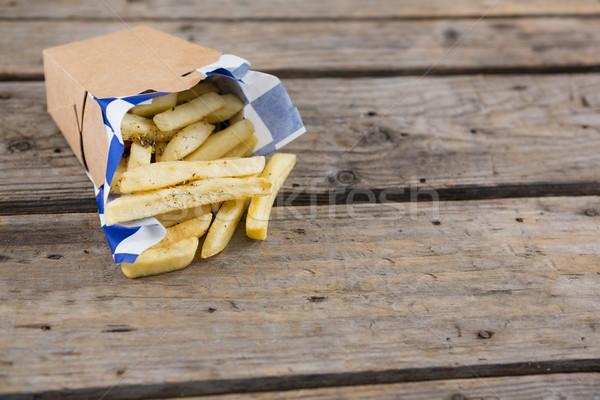 Patatine fritte contenitore tavola tavolo in legno carta Foto d'archivio © wavebreak_media