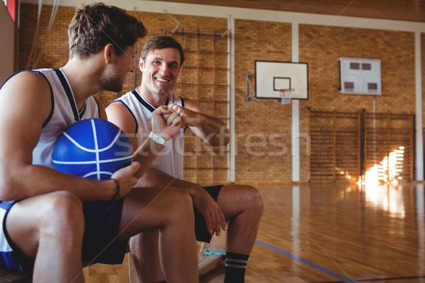 Gelukkig basketbal spelers vuist buil vergadering Stockfoto © wavebreak_media