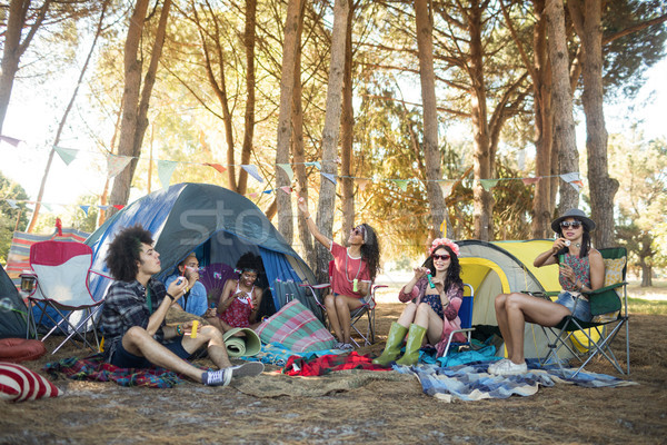 Young friends enjoying together at campsite Stock photo © wavebreak_media