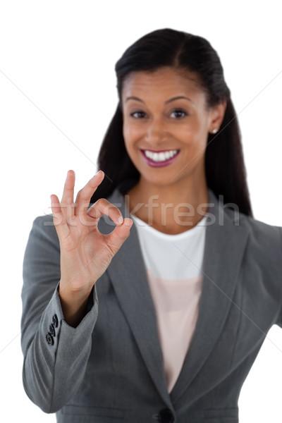 Souriant femme d'affaires ok signe de la main main Photo stock © wavebreak_media