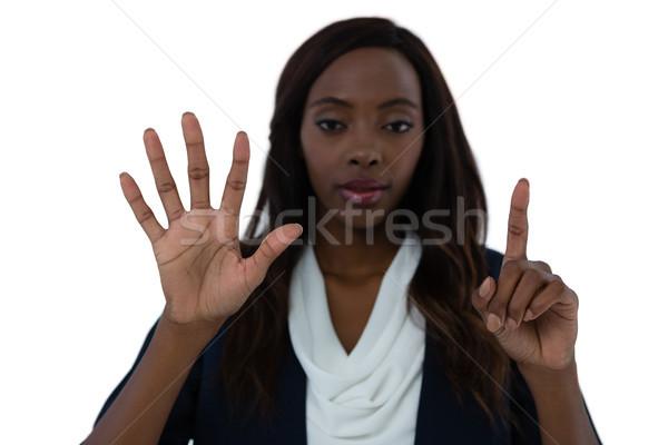 портрет деловая женщина невидимый интерфейс экране белый Сток-фото © wavebreak_media