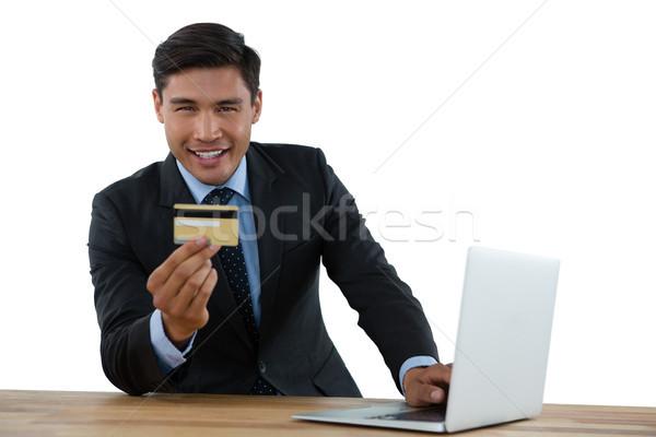 портрет бизнесмен кредитных карт используя ноутбук таблице Сток-фото © wavebreak_media