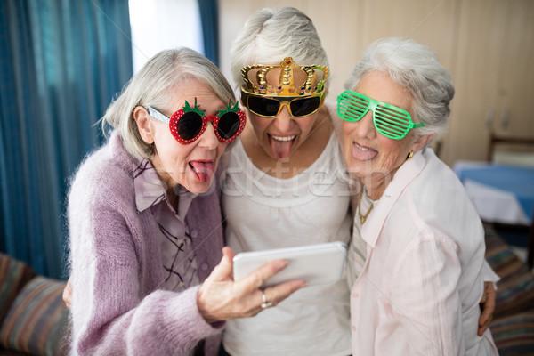 Starszy kobiet nowość okulary Zdjęcia stock © wavebreak_media