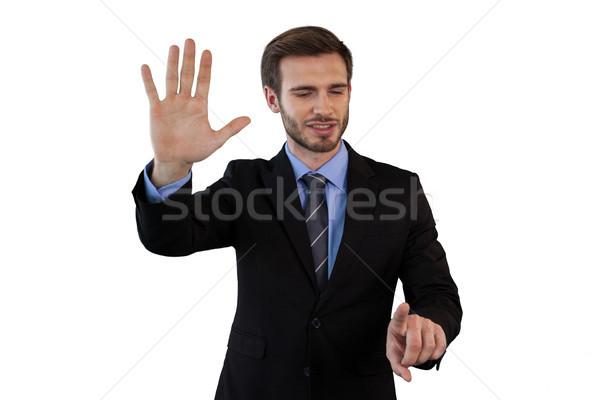 улыбаясь бизнесмен костюм невидимый интерфейс Постоянный Сток-фото © wavebreak_media