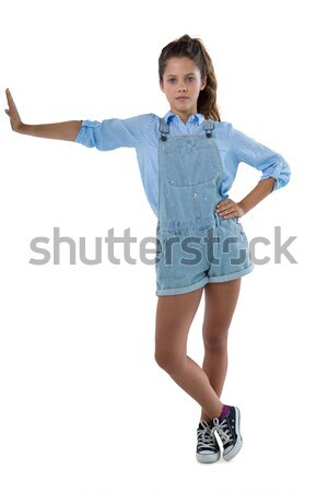 Portrait of teenage girl leaning on the side Stock photo © wavebreak_media