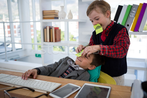 Kid as business executives playing with sticky notes Stock photo © wavebreak_media