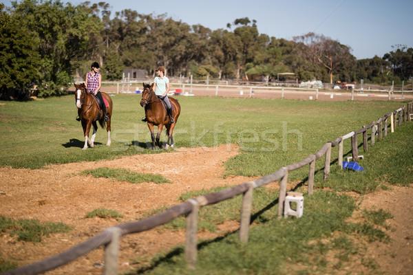 Mid distant view of female friends horseback riding Stock photo © wavebreak_media