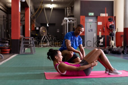Trener ściany wspinaczki siłowni mężczyzna Zdjęcia stock © wavebreak_media