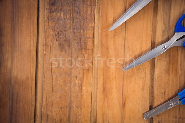 Image ciseaux table en bois bureau table bleu Photo stock © wavebreak_media