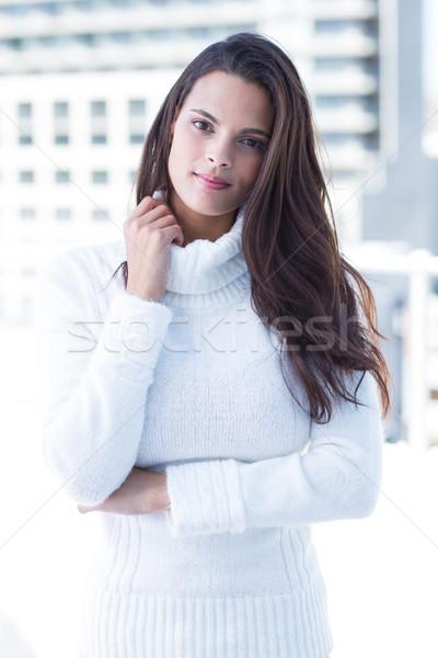 Nadenkend vrouw naar camera hand Blauw Stockfoto © wavebreak_media