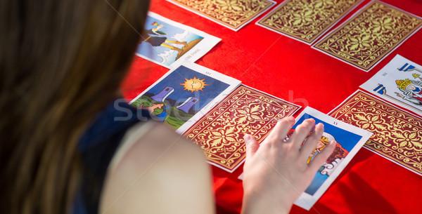 Falcı tarot kartları kırmızı tablo kadın Stok fotoğraf © wavebreak_media