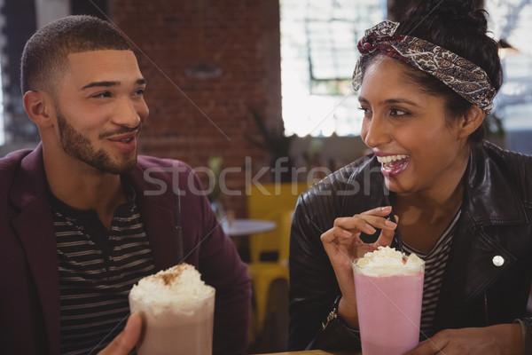 Barátok élvezi kávézó boldog fiatal technológia Stock fotó © wavebreak_media