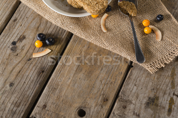 Granola bar and berry fruit on wooden table Stock photo © wavebreak_media