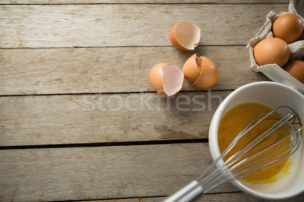 Directly above shot of eggs in bowl and carton Stock photo © wavebreak_media