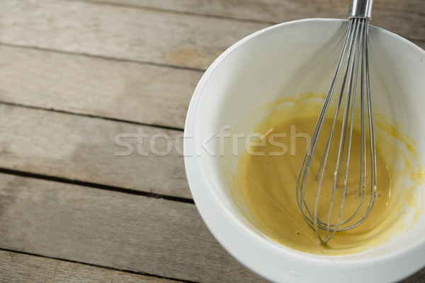 High angle view batter and wire whisk in bowl Stock photo © wavebreak_media