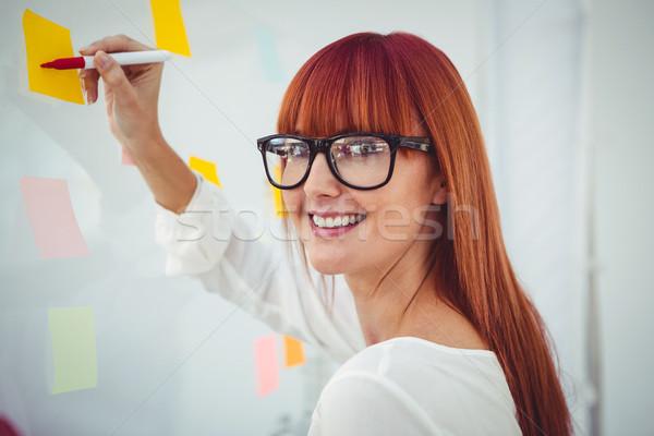 魅力的な ヒップスター 女性 書く 付箋 オフィス ストックフォト © wavebreak_media