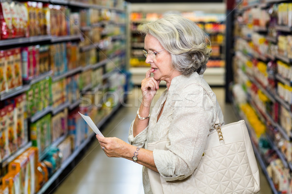 Senior woman checking list Stock photo © wavebreak_media
