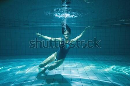 Stock photo: Pretty woman stretching underwater
