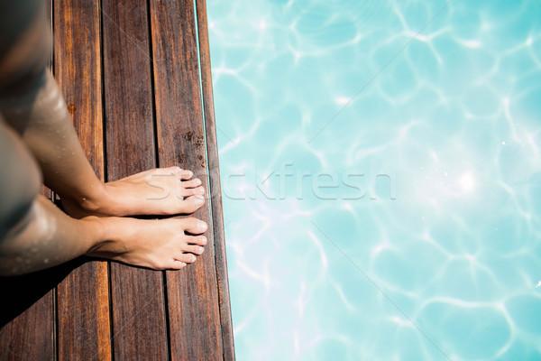 женщину ног край ногу Бассейн отпуск Сток-фото © wavebreak_media