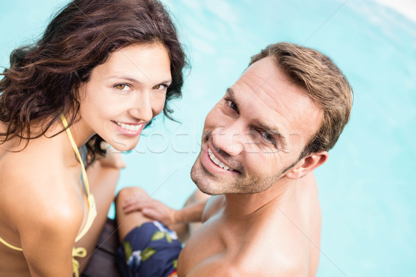 Close-up of young couple sitting by poolside Stock photo © wavebreak_media