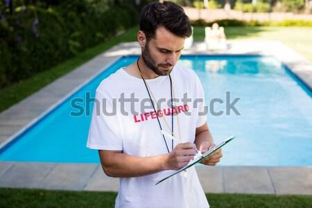 Handsome man using computer Stock photo © wavebreak_media
